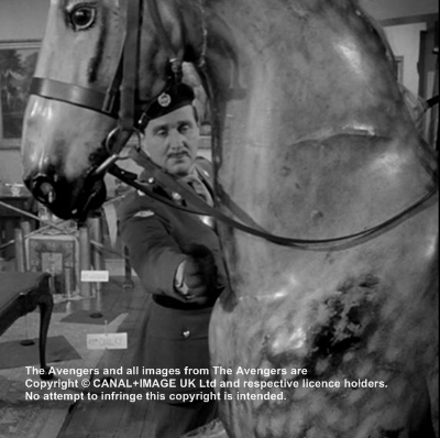 "Steed and plastic horse in ""What the Butler Saw"""